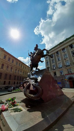 Architecture Built Structure City Cloud - Sky Day Dragon Horse Horse Riding Low Angle View Overcomer Rider Sculpture Sky Statue Sun Sunlight