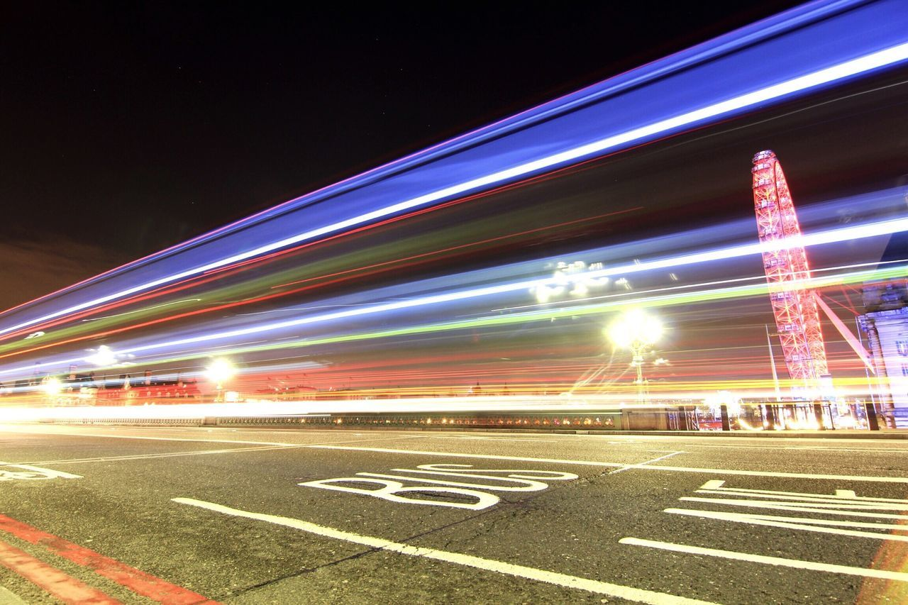 Long Exposure Of Tail Lights On Road