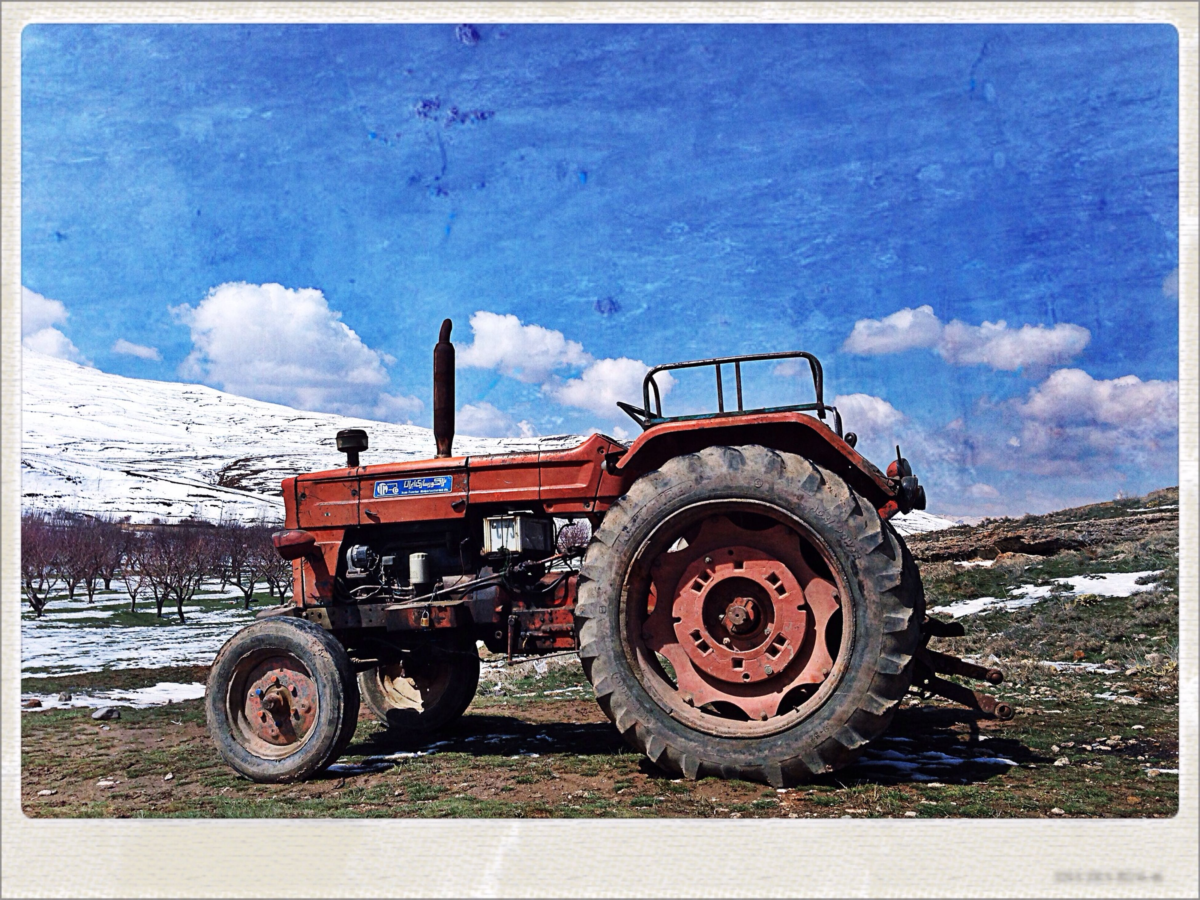 transportation, mode of transport, land vehicle, transfer print, sky, stationary, auto post production filter, wheel, parking, parked, bicycle, cloud - sky, outdoors, abandoned, day, car, no people, building exterior, built structure, tire