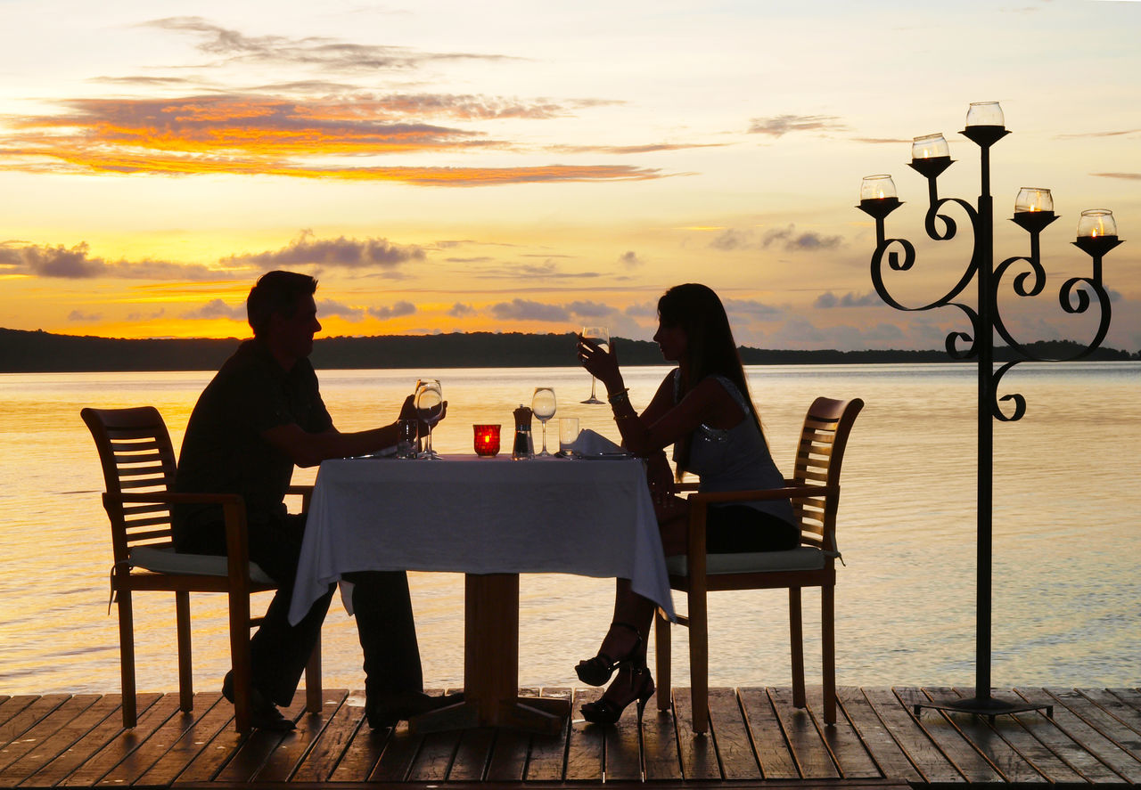 star light dinner Havannah Harbour Port Vila, Vanuatu Beauty In Nature Chair Cloud Full Length Harbour Havannah Men Ocean Outdoors Person Restaurant Romantic Sky Scenics Sea Sitting Sky Sunset Table Togetherness Tranquil Scene Tranquility Vanuatu Water