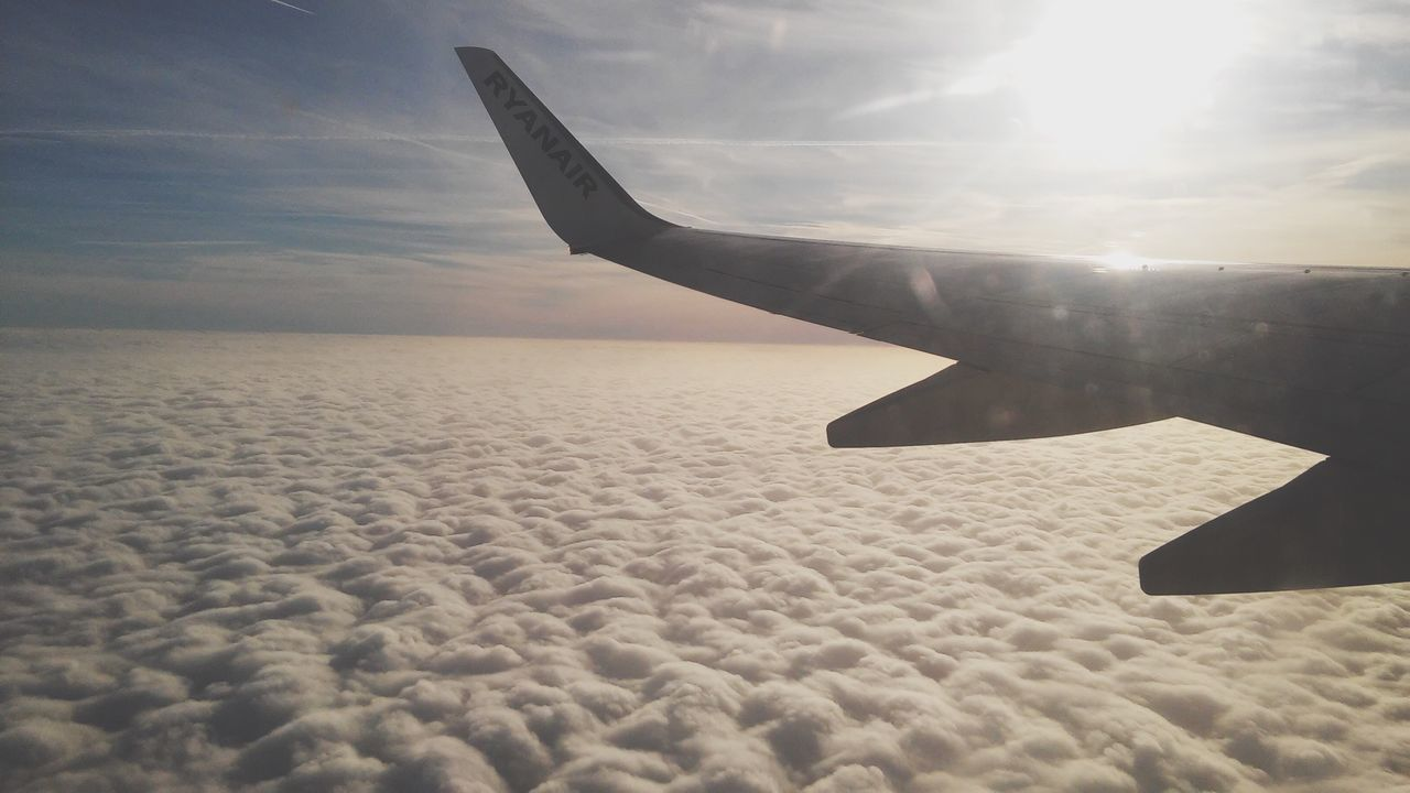 airplane, sky, transportation, journey, nature, aerial view, airplane wing, cloud - sky, flying, mode of transport, beauty in nature, mid-air, air vehicle, aircraft wing, scenics, travel, outdoors, tranquil scene, sun, day, tranquility, no people, landscape, vehicle part, sunset, sea, water, horizon over water
