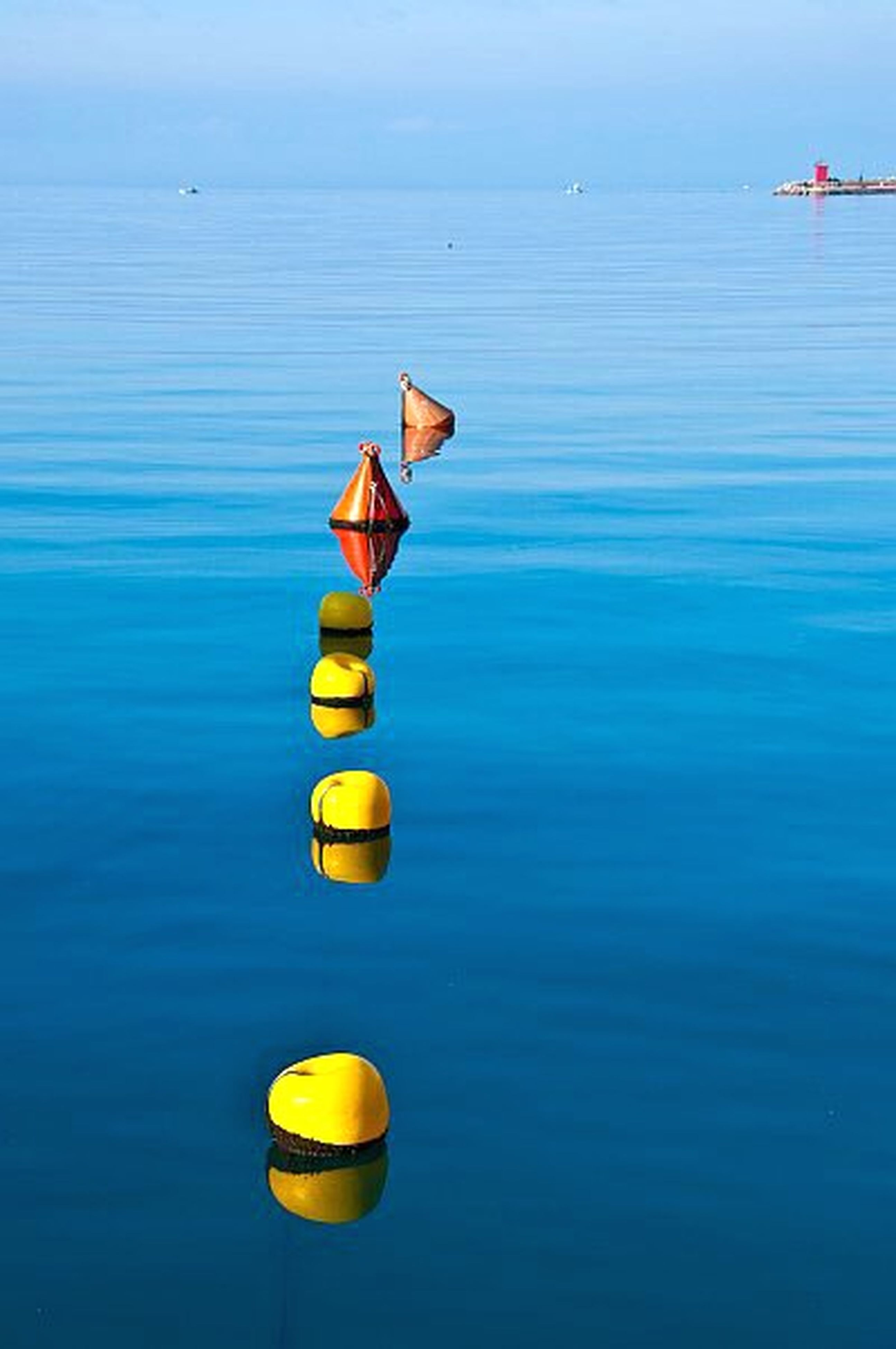 water, waterfront, sea, blue, buoy, multi colored, nautical vessel, boat, transportation, rippled, lake, reflection, tranquility, no people, day, yellow, outdoors, nature, rope, mode of transport