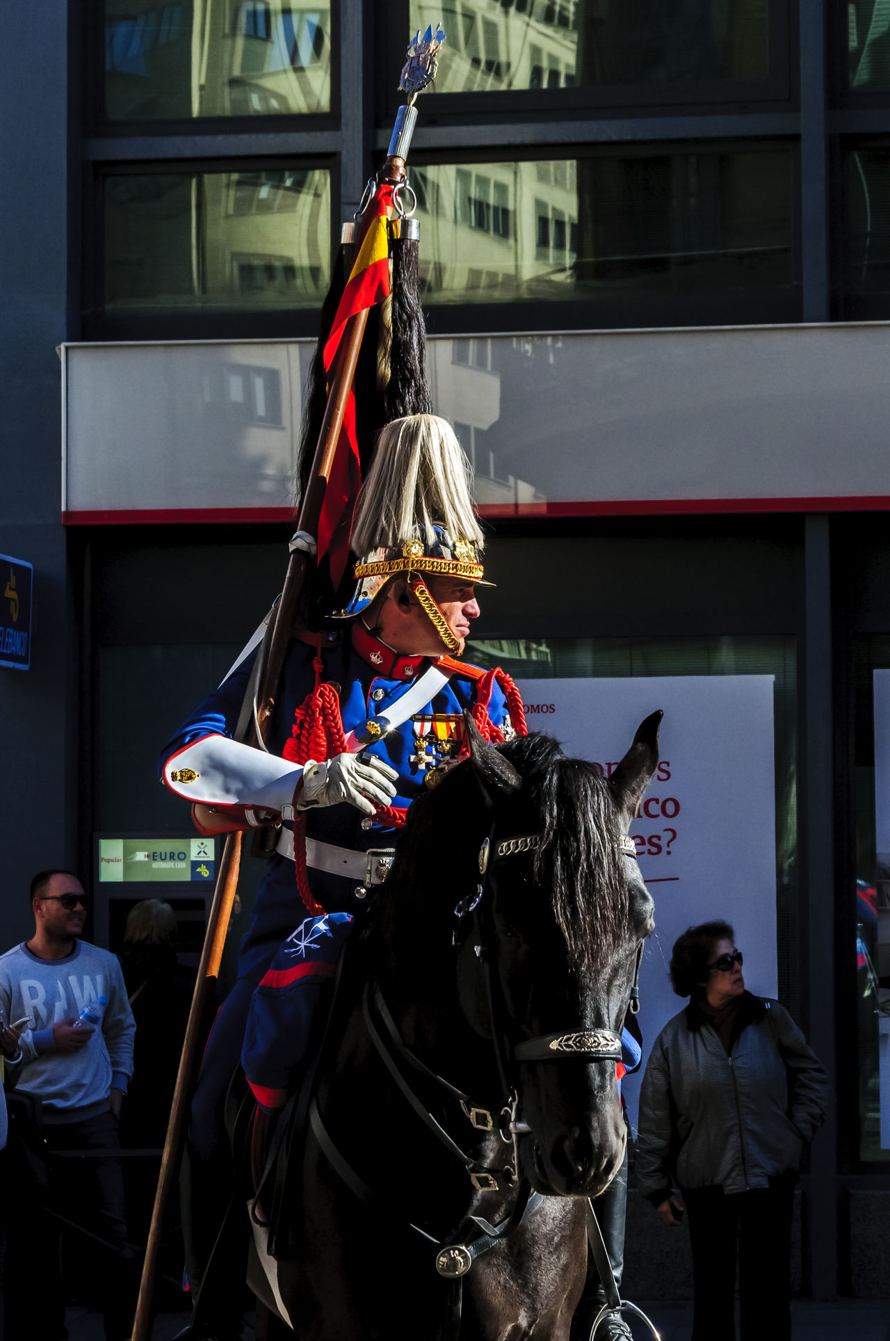 A half view of a Cavalery soldier mounted on a black horse. Adult Cavalry Cavalry Soldier City Day Editorial  Guard Horse Horse Riding Horses Mammal Military Mounted News People Shillouette Street Uniform Uniforms