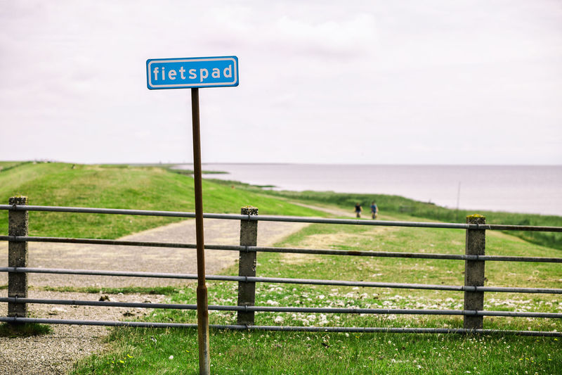 Bike Lane Netherlands Schiermonnikoog Beauty In Nature Bicycle Cycling Grass Green Color Guidance Horizon Over Water Island Nature Outdoors Sea Street Sign Tranquil Scene Water