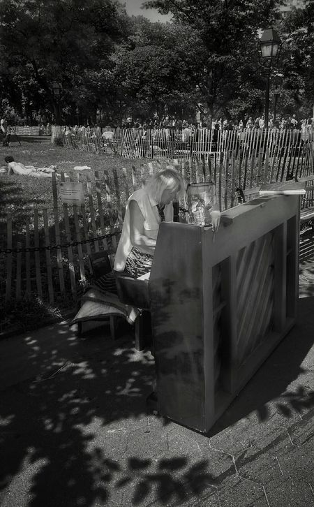Piano lady playing her heart out. Washingtonpark Streetphotography Black And White Monochrome Newyork Shadows Reflections HTC New York Angles And Lines
