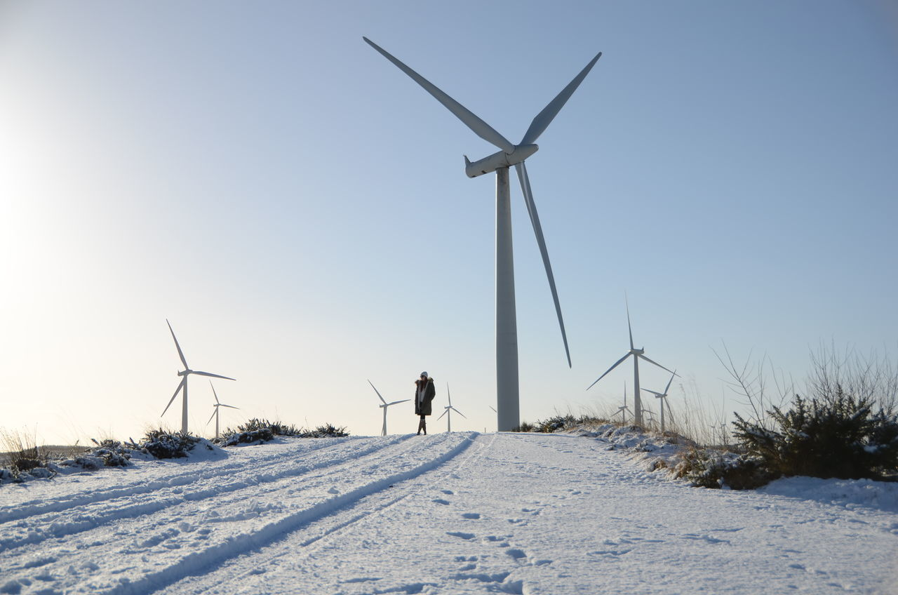 Alternative Energy Cold Temperature Environmental Conservation Field Horizon Landscape Remote Scotland Snow Snow Covered The Way Forward Tranquility Weather Wind Energy Wind Power Wind Turbine Wind Turbines Windmill Winter Woman