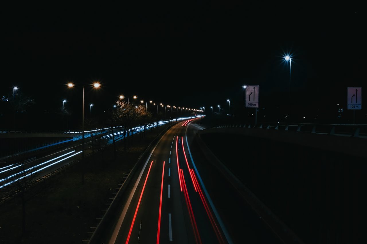 Blurred Blurred Motion Bokeh City City Life Colours Dark Highway Illuminated Light Trail Lights Long Exposure Motion Night Nightphotography No People Outdoors Road Sky Speed Street Street Light Traffic Transportation