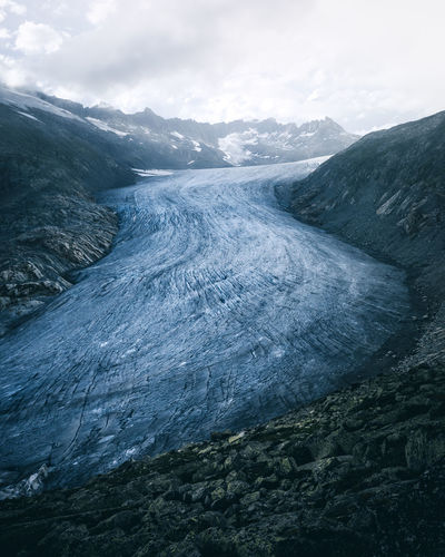The melting Rhone Glacier during summer. Gletscherschwund Ice Impressive Melting Rhône Alps Alps Switzerland Beauty In Nature Day Furkapass Glacier Landscape Landscapes Mood Moody Mountain Nature No People Outdoors Scenics Sky Snow Summer Tranquil Scene Tranquility The Week On EyeEm