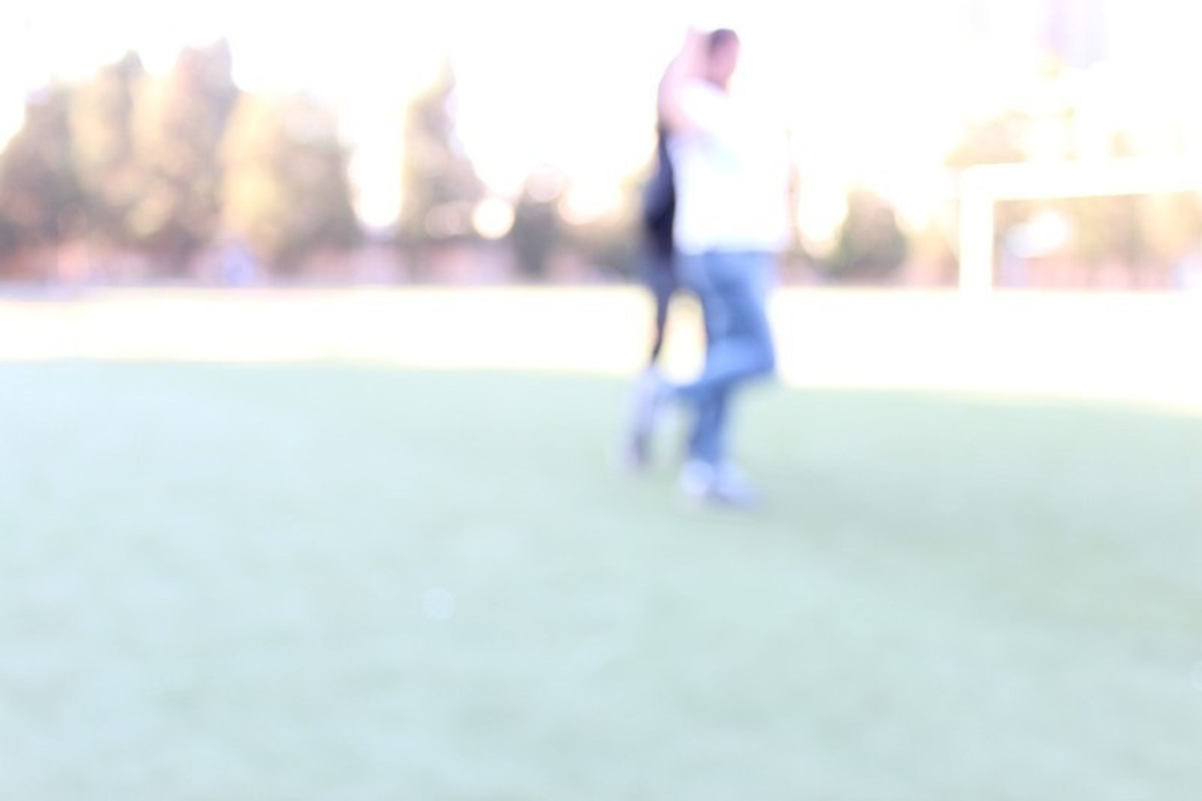 lifestyles, focus on foreground, selective focus, leisure activity, walking, men, person, rear view, standing, surface level, day, defocused, outdoors, unrecognizable person, low section, casual clothing, sunlight