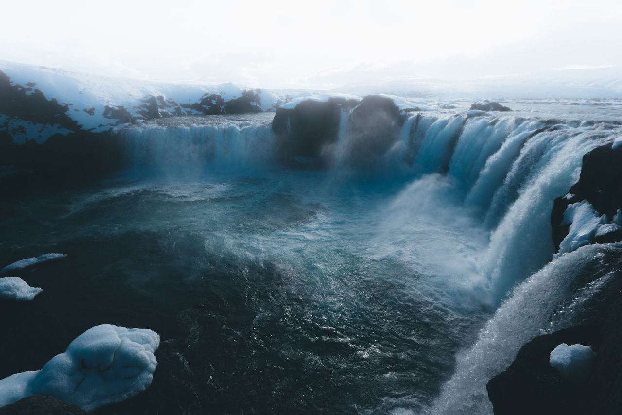 Godafoss waterfall in Iceland Beauty In Nature Cold Temperature Day Iceberg Long Exposure Motion Nature No People Outdoors Power In Nature Scenics Sky Water Waterfall Winter