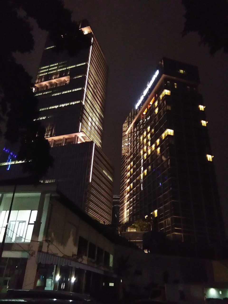 architecture, building exterior, night, illuminated, built structure, low angle view, city, skyscraper, modern, sky, no people, outdoors, cityscape