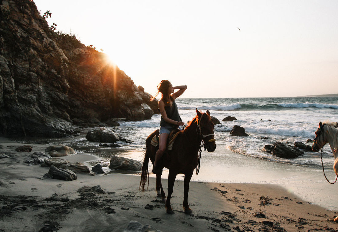 Woman horseback riding at the beach during sunset Beach Beauty In Nature Day EyeEmNewHere Full Length Horse Horse Back Riding Leisure Activity Lifestyles Nature One Person Outdoors Real People Romantic Sand Sea Sky Sunset Sunsets Travel Water Wave Woman Women Young Adult