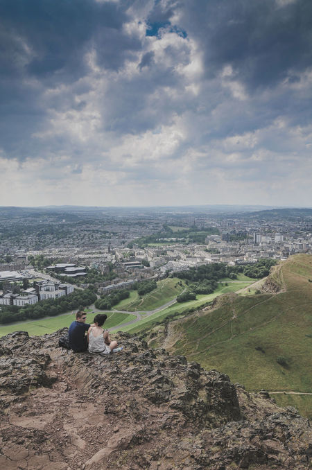 View on the Edinburgh skyline from Arthur's Seat and a happy couple enjoying it Arthur's Seat City Cityscape Couple Day Edinburgh Great Britain Landscape Nature Nature Outdoors Romantic Romantic Sky Scenics Scotland Scotland Highlands Sky Travel Travel Destinations Travel Lover Traveling Urban Skyline Vacations