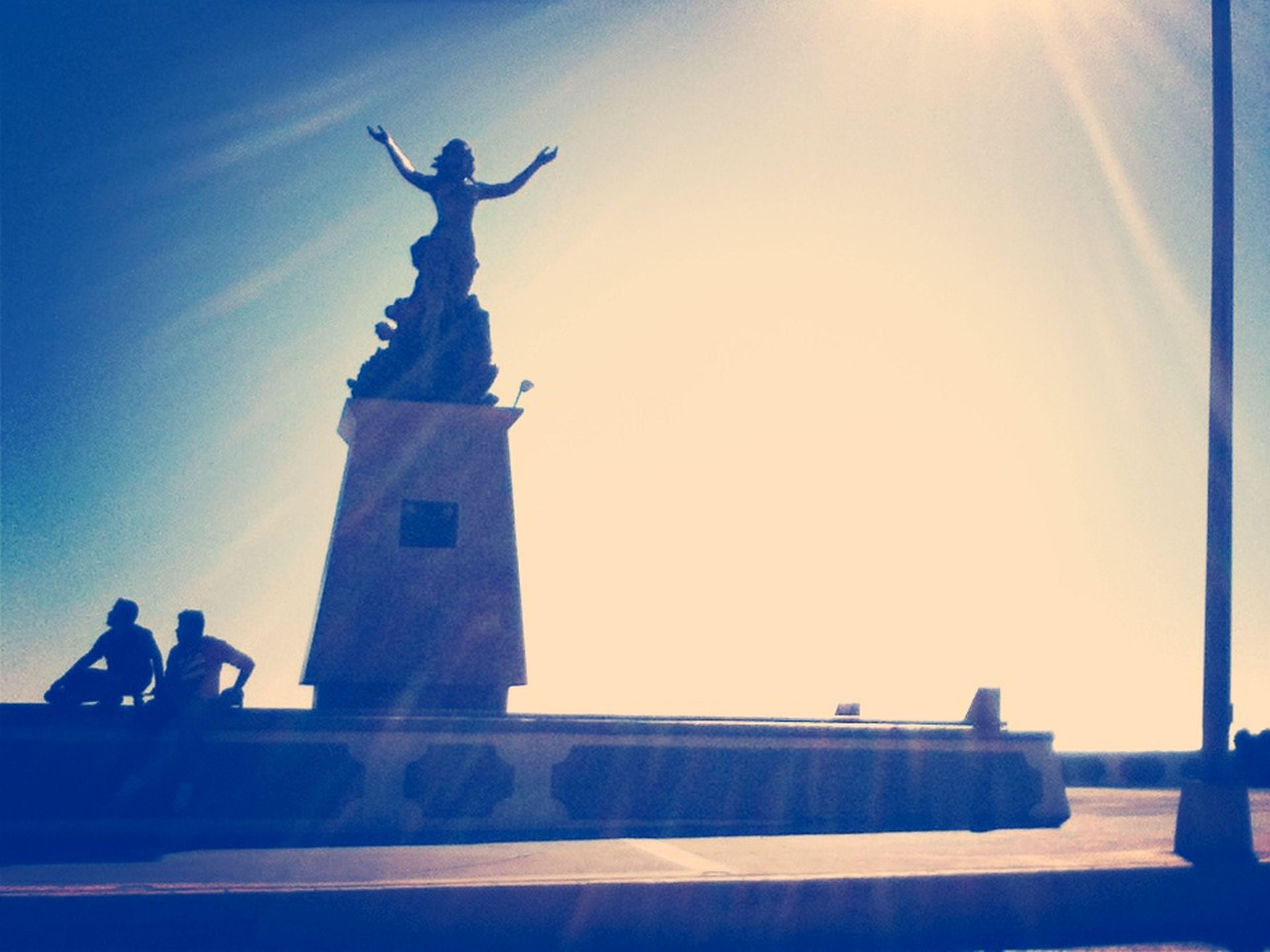 statue, human representation, sculpture, low angle view, clear sky, art and craft, blue, silhouette, art, famous place, creativity, travel, travel destinations, tourism, copy space, sky, built structure, international landmark