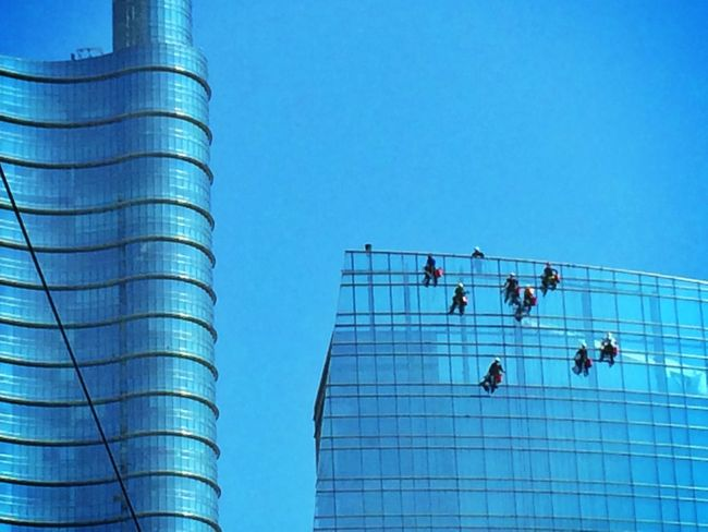 Men At Work  Working Working Hard Building And Sky Building Window Cleaning Window Cleaner Hanging Out Blue Blue Sky