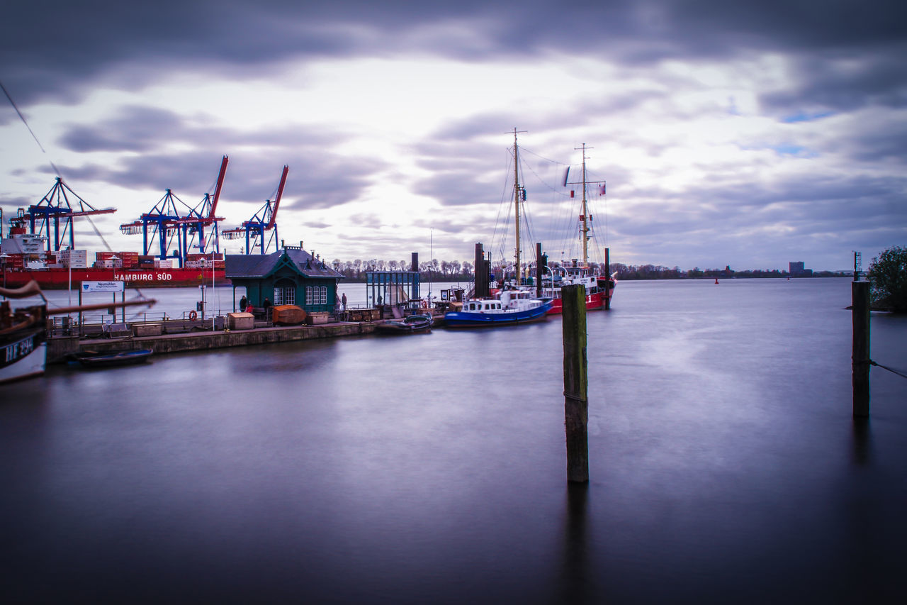 nautical vessel, cloud - sky, transportation, harbor, sky, water, mode of transport, moored, sea, commercial dock, outdoors, no people, mast, travel destinations, nature, day, shipyard