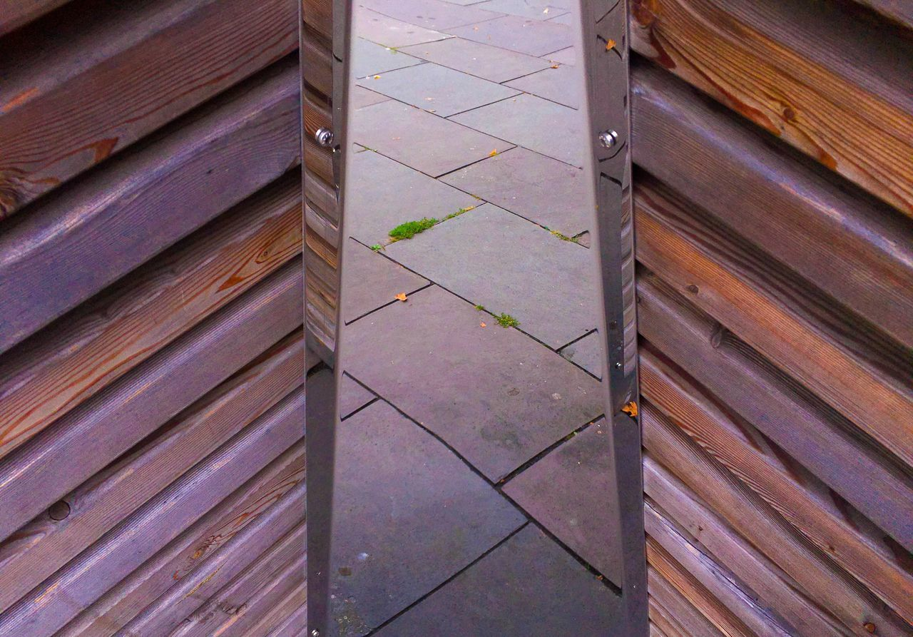 High Angle View Of Footpath Seen Through Wooden Doorway