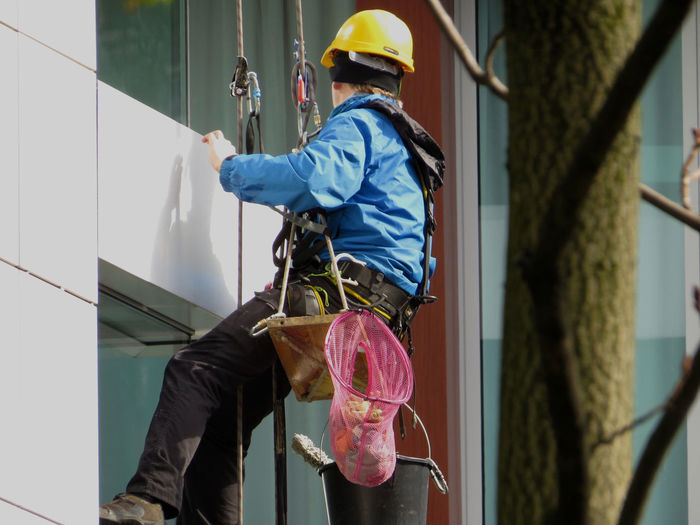 Cleaning Equipment Cleaning Glasses Hanging Man At Work Outdoors Outside My Window Sunny Day Window Cleaning Working Snap A Stranger