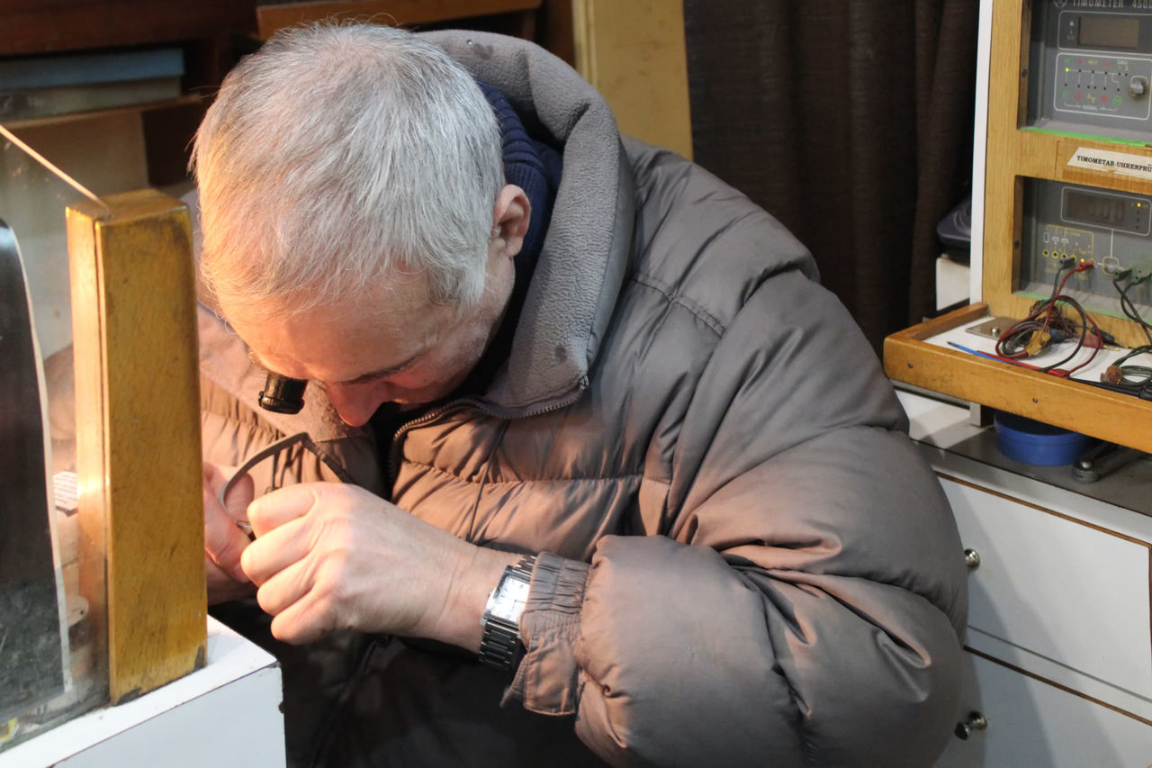 real people, one person, indoors, senior adult, occupation, working, men, day, wristwatch, workshop, time, human hand, people
