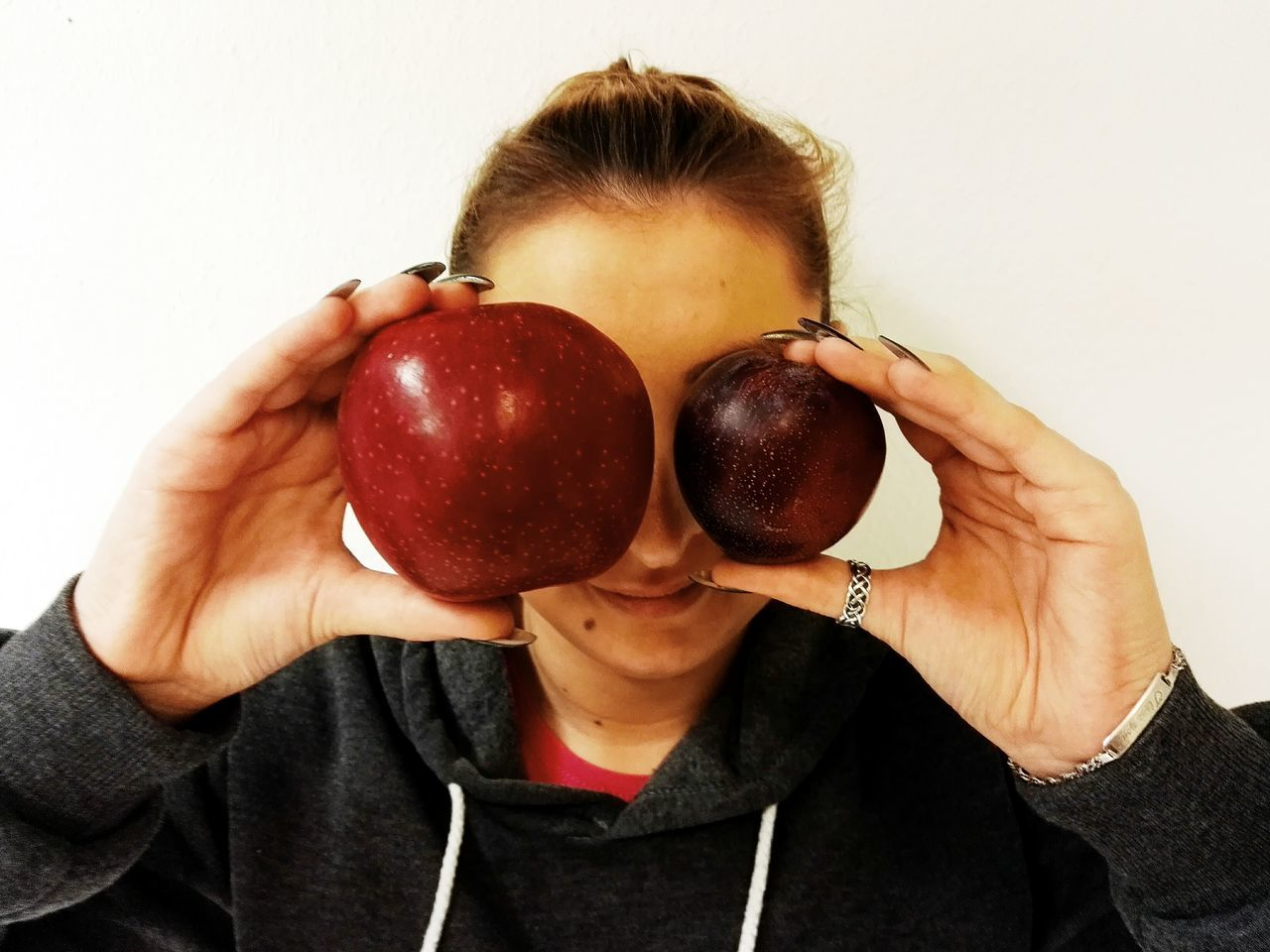 Luck in my eyes One Person Human Body Part People Holding Adult Fruit Indoors  Food Women Close-up Human Hand White Background Young Adult Day Apple Diet Lifestyle Funny Faces Fun Funny Fruits Adults Only Only Men