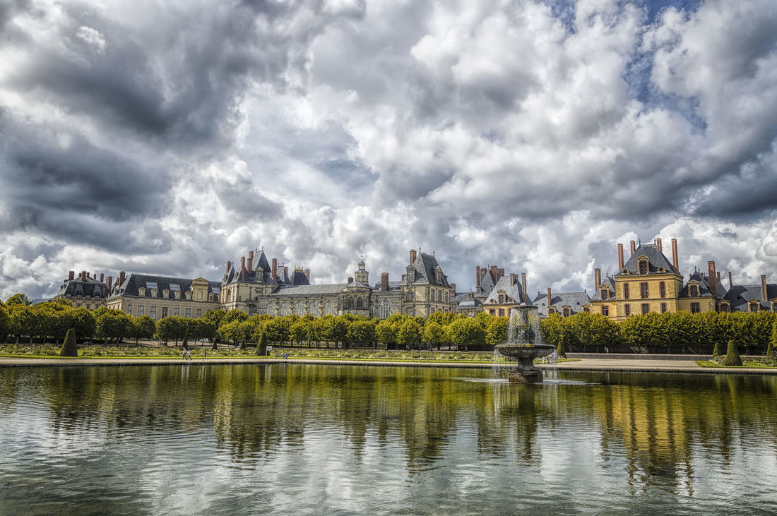 Chateau and water reflections a cloudy day Architecture Beauty In Nature Building Exterior Château Cloud Cloud - Sky Cloudscape Cloudy Day Famous Place Fontainebleau History Lake Monument Nature Outdoors Reflection Scenics Sky Tourism Tranquil Scene Tranquility Travel Destinations Water Waterfront