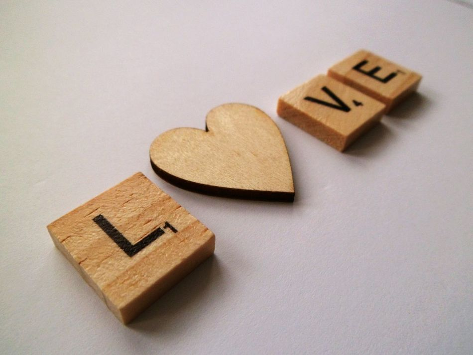 L💛VE letters Leisure Games Creativity The Alphabet Leisure Activity Text Indoors  Slanted Focus On Foreground Still Life Words Phrase Plain Background White Background Word Game Communication Studio Shot Western Script Close-up No People Art And Craft Capital Letter Low Angle View Love Wood - Material