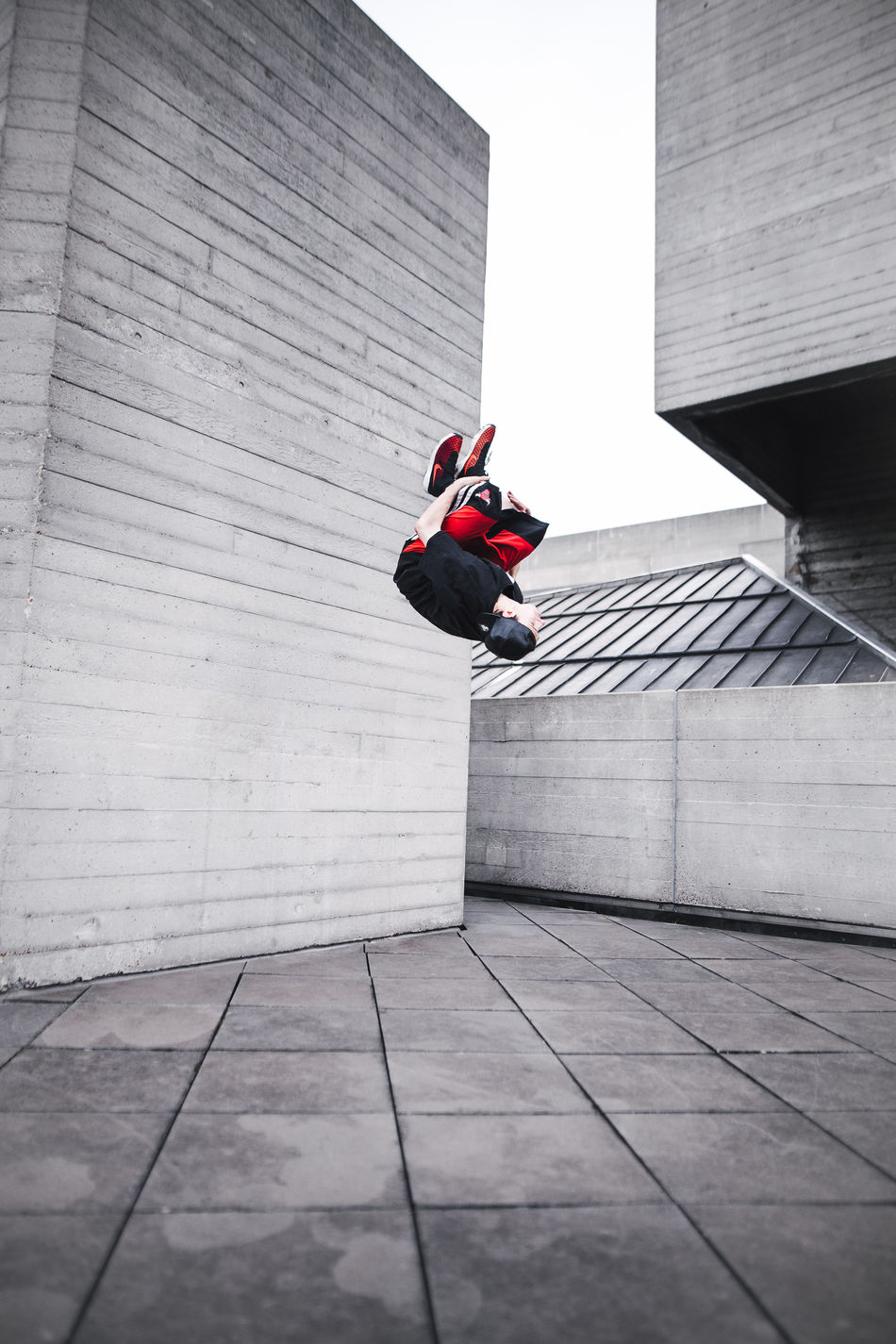 NT // Architecture Awesome Backflip Brutalism Brutalist Architecture Building Exterior Built Structure Check This Out City City Colors Cool Day Freerunning Jumping Leisure Activity London Motion One Person Outdoors Red SB Streetphotography Urban White