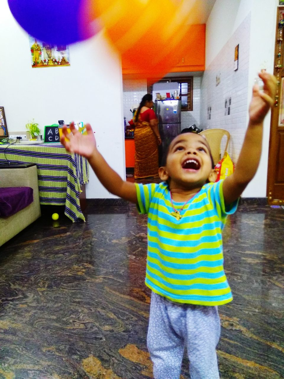 childhood, striped, casual clothing, real people, mouth open, boys, elementary age, happiness, standing, fun, enjoyment, playing, leisure activity, girls, indoors, home interior, two people, day, lifestyles, multi colored, smiling, people