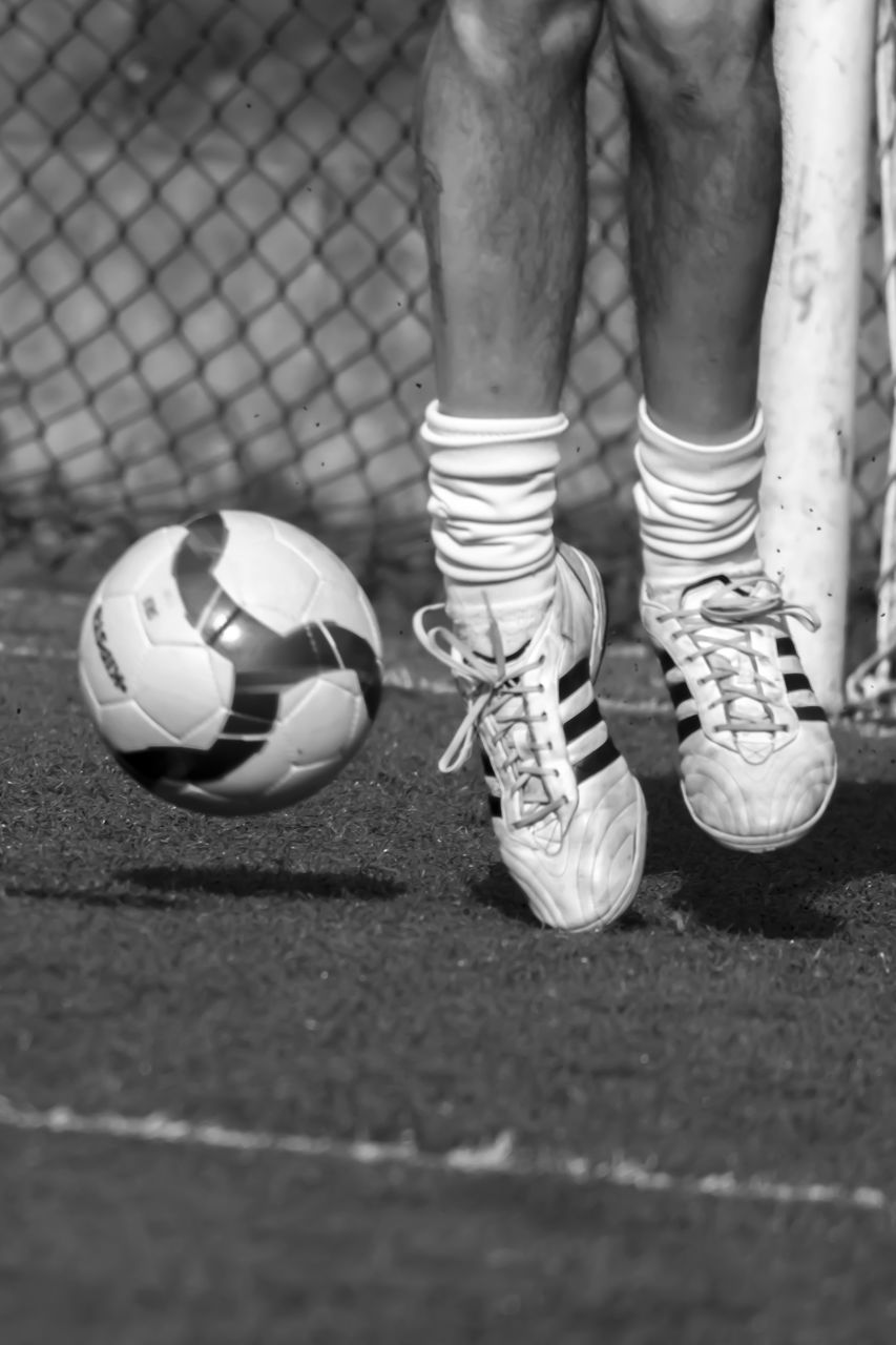 soccer, low section, ball, sport, day, standing, outdoors, real people, human body part, close-up, people