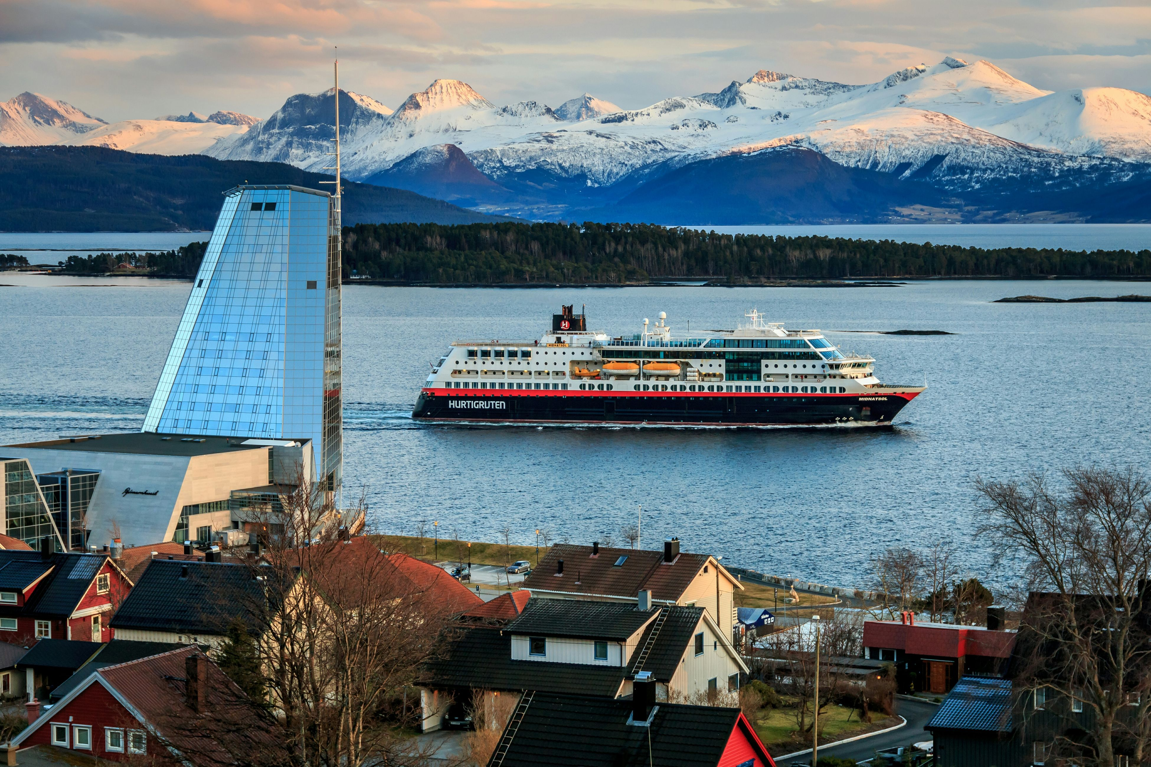 Coastal Express Midnatsol sailing from the port of Molde. The tall building is the hotel Scandic Seilet. Nature Sky And Clouds Mountains Water_collection Sea Snow