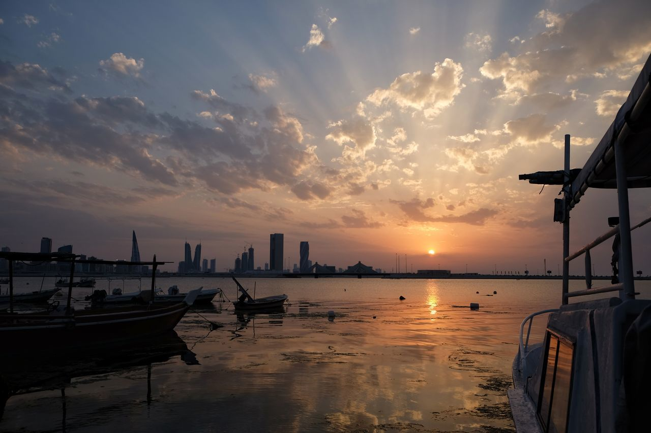 Sunset Urban Skyline Calm Sea Fishing Boats Nautical Vessel Reflection Tranquil Scene