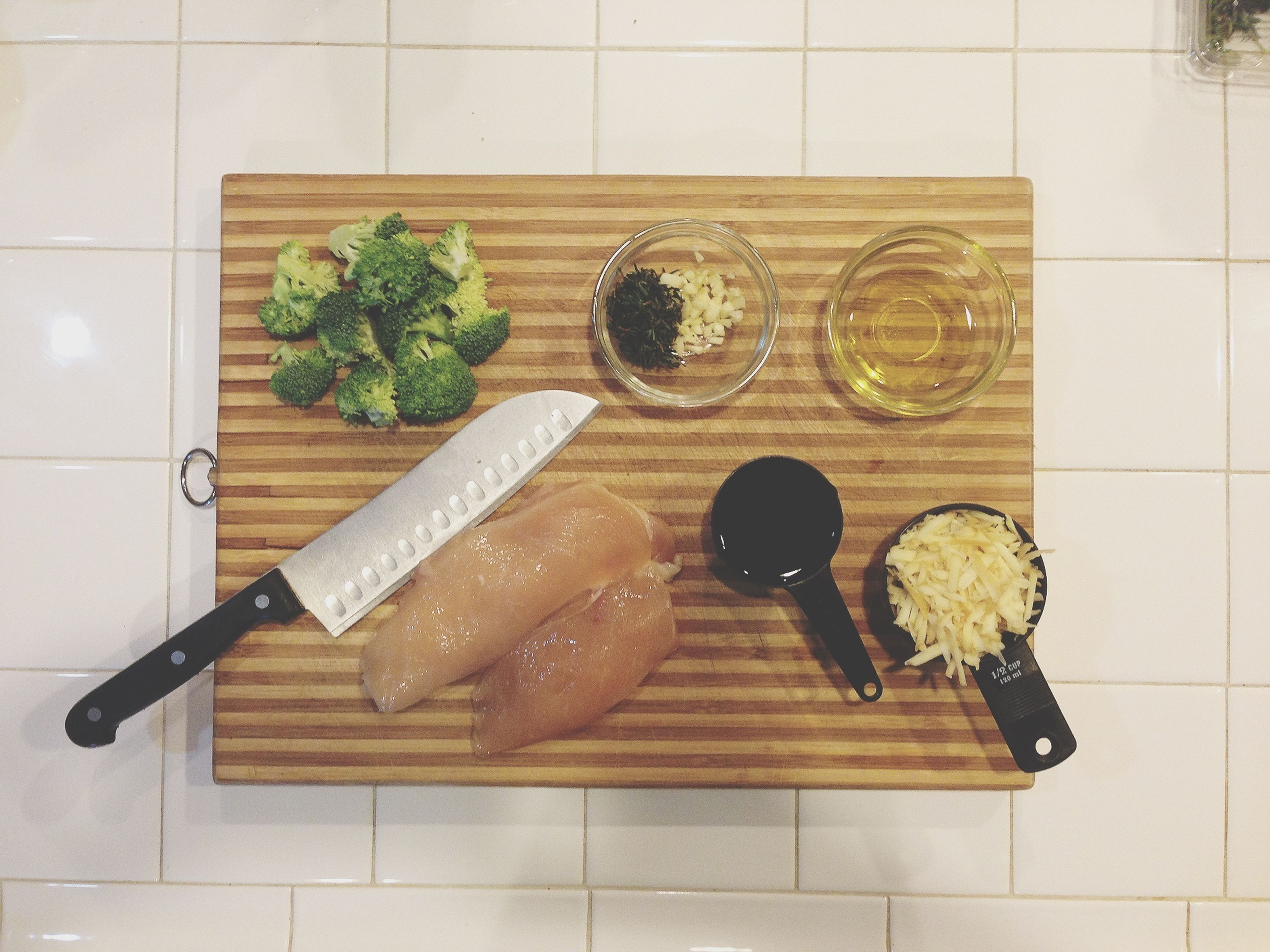 indoors, food and drink, food, freshness, table, still life, high angle view, cutting board, healthy eating, directly above, wood - material, preparation, plate, vegetable, ready-to-eat, kitchen knife, fork, bread, overhead view, meal