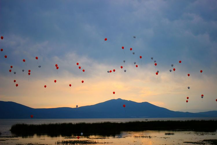Chapala Lake Sky Outdoors Landscape Nature Water Beauty In Nature Day Sunset Chapala Lake Balloons Ballon Lake Lake View Mountain Mountain View Blue Hour Golden Hour