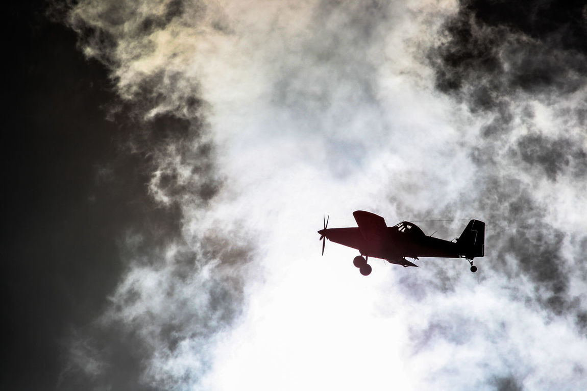 Air Tractor AT-802 Airplane Cloud Cloud Cloud - Sky Dark Darkness And Light Dramatic Sky Flight Light Light And Shadow Silhouette Sky Sun