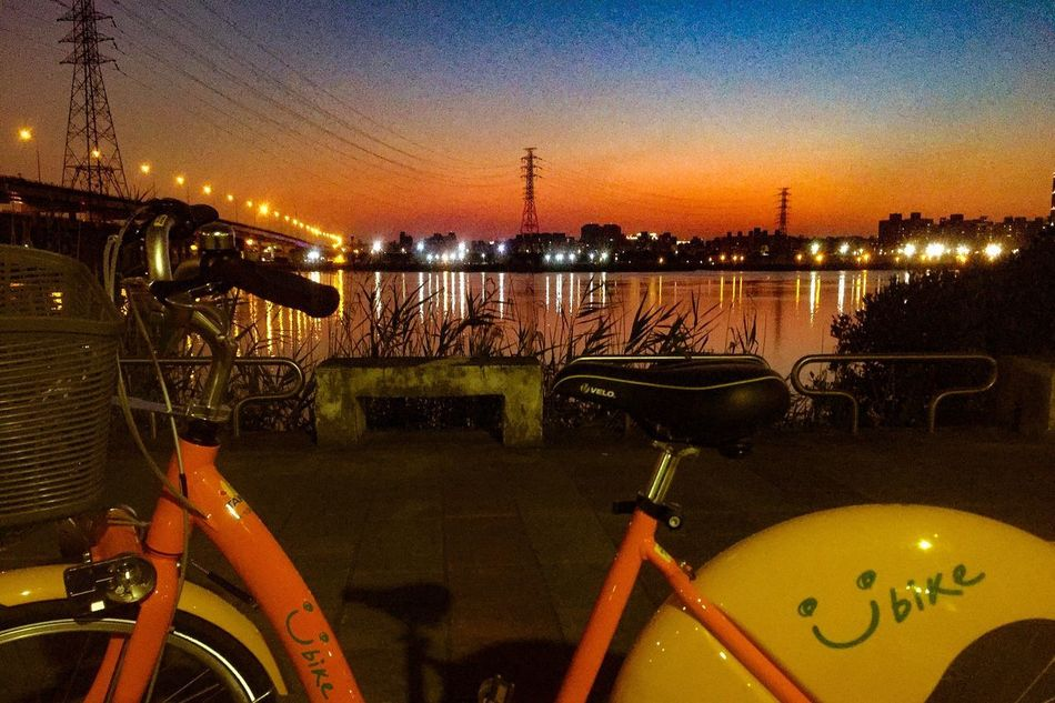 The city I live is an interesting and handy place. Enjoy the public bicycles of world famous GIANT brand everywhere. I think the bike company should buy my picture because this view was so amazing. Transportation Mode Of Transport Bicycle Illuminated Night Sunset Sky City Outdoors Nature EyeEmNewHere Welcome To Black Ubike Emotional Photography Travel Photography Streetphotography Catch The Moment Tranquility Beauty In Nature Multi Colored Cycling Street Photography Taipei,Taiwan Taipei City Senery