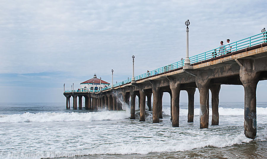 Watching the surf Manhattan Pier High Tide California Beach EyeEm X Getty Images