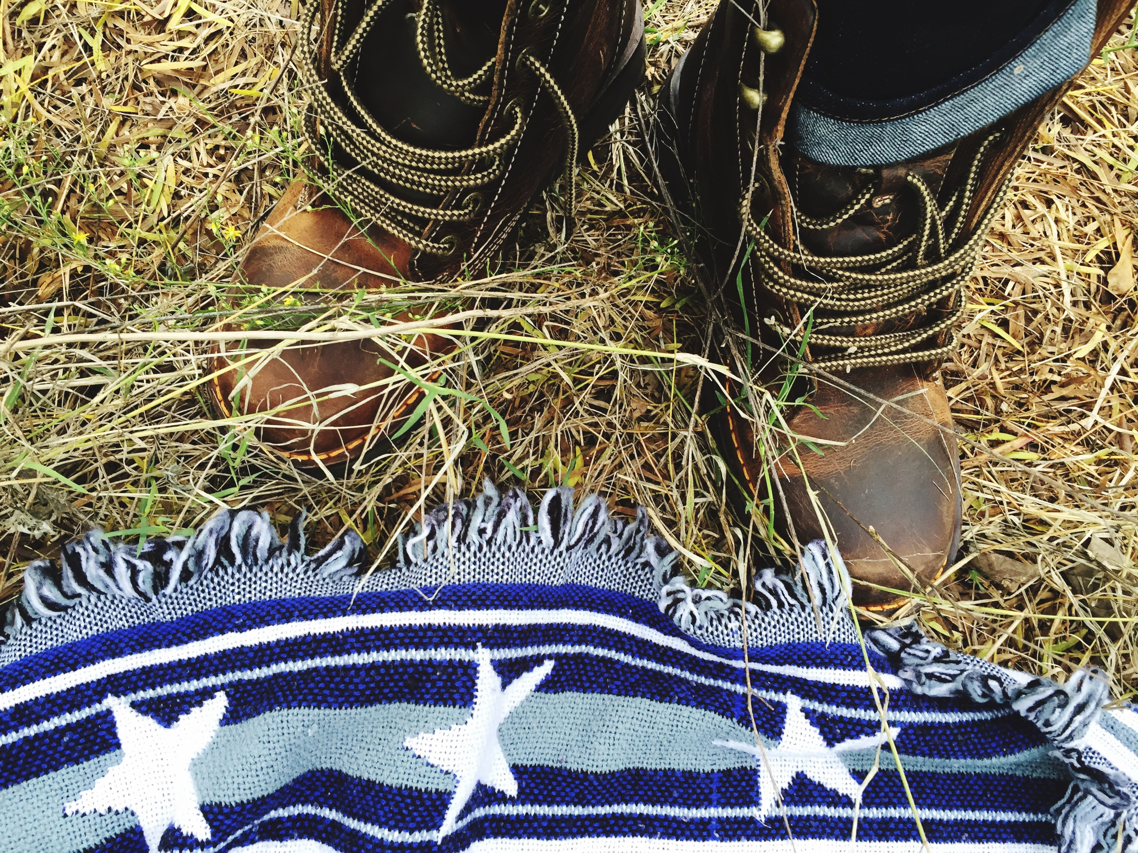 high angle view, shoe, pattern, low section, close-up, design, person, footwear, part of, creativity, art and craft, directly above, blue, pair, outdoors, jeans, full frame, field, grass, day