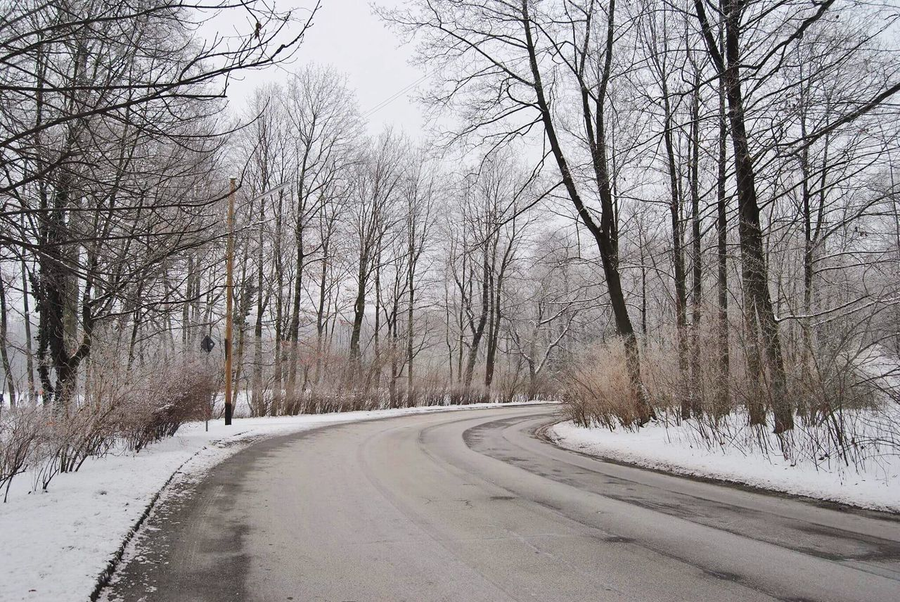 bare tree, road, winter, cold temperature, snow, the way forward, transportation, tree, nature, outdoors, tranquility, day, no people, scenics, beauty in nature, sky