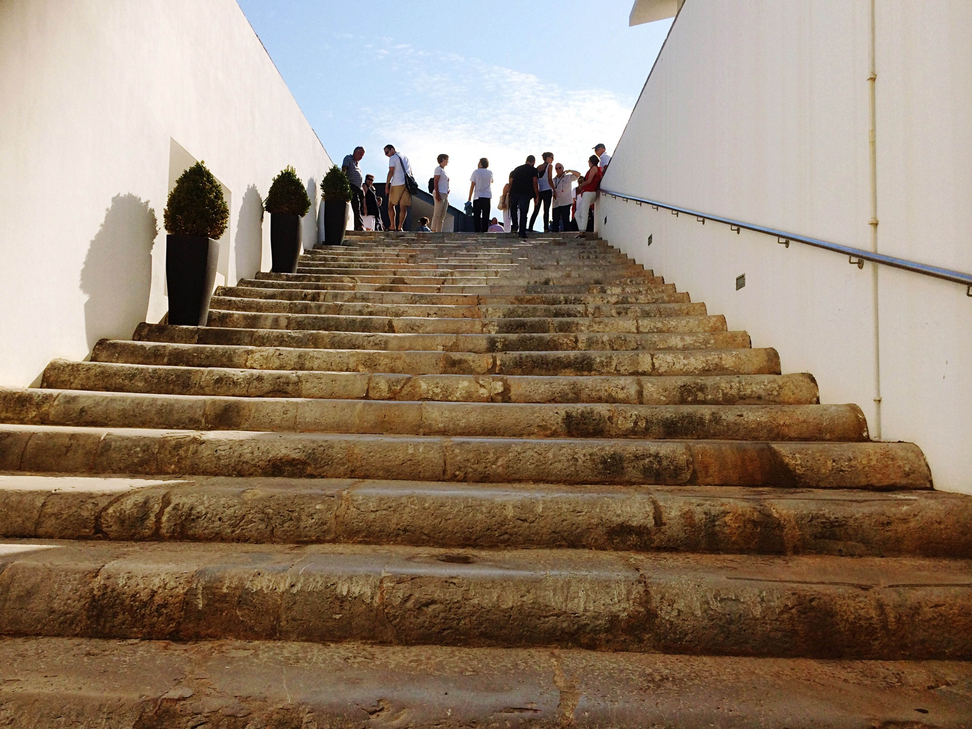 steps, steps and staircases, architecture, built structure, staircase, the way forward, building exterior, low angle view, stairs, railing, diminishing perspective, sunlight, history, famous place, sky, travel destinations, day, in a row, tourism, travel