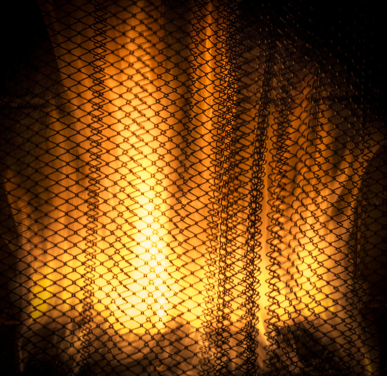 Backgrounds Black Background Close-up Flame Flames Grate Illuminated Indoors  Light Effect Long Exposure No People Orange Orange Color Pattern Screen Textured  Yellow Yellow Color Combustion Arson  Pyro