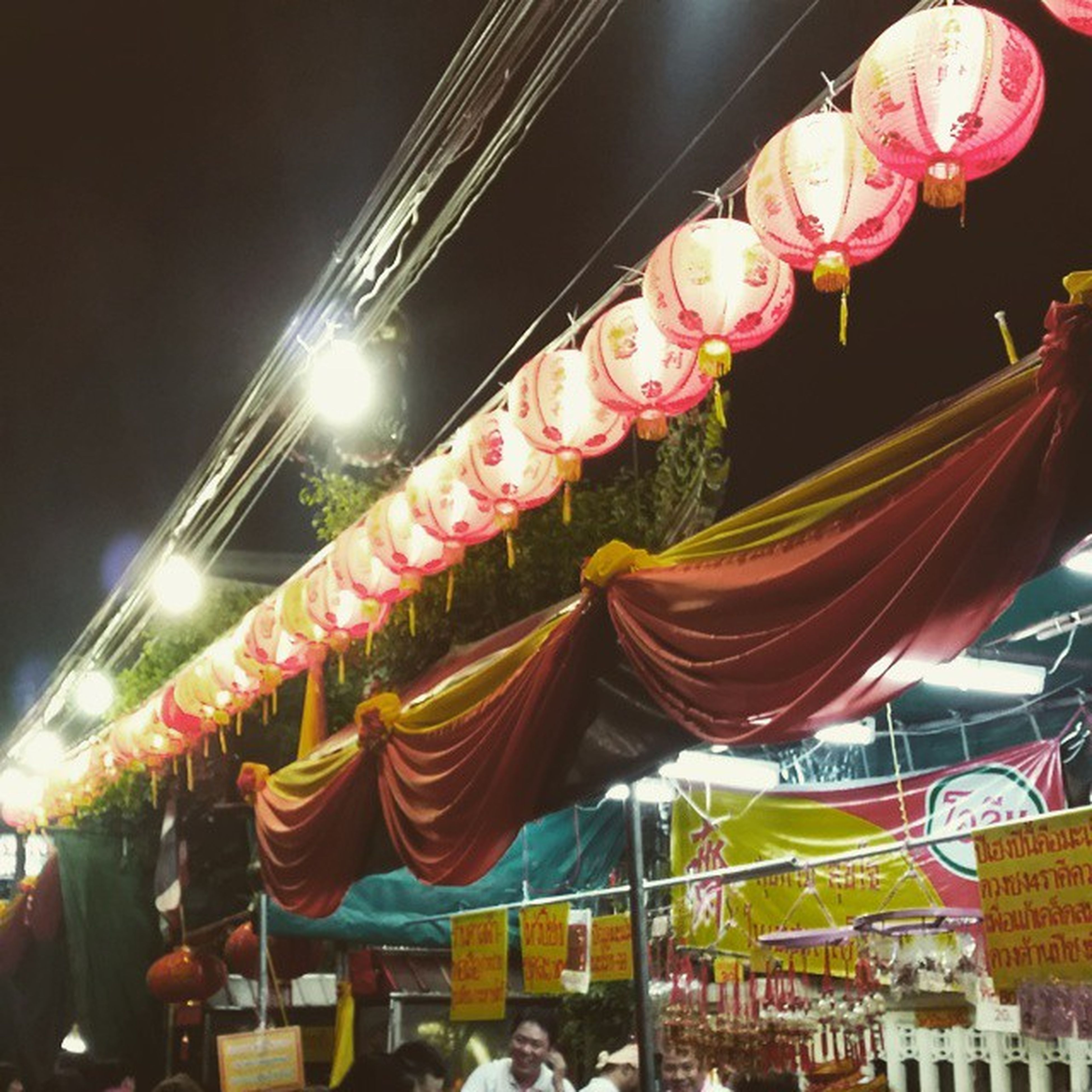 multi colored, low angle view, illuminated, hanging, decoration, celebration, cultures, arts culture and entertainment, large group of people, market, traditional festival, night, amusement park, tradition, retail, variation, amusement park ride, choice, chinese lantern, lantern