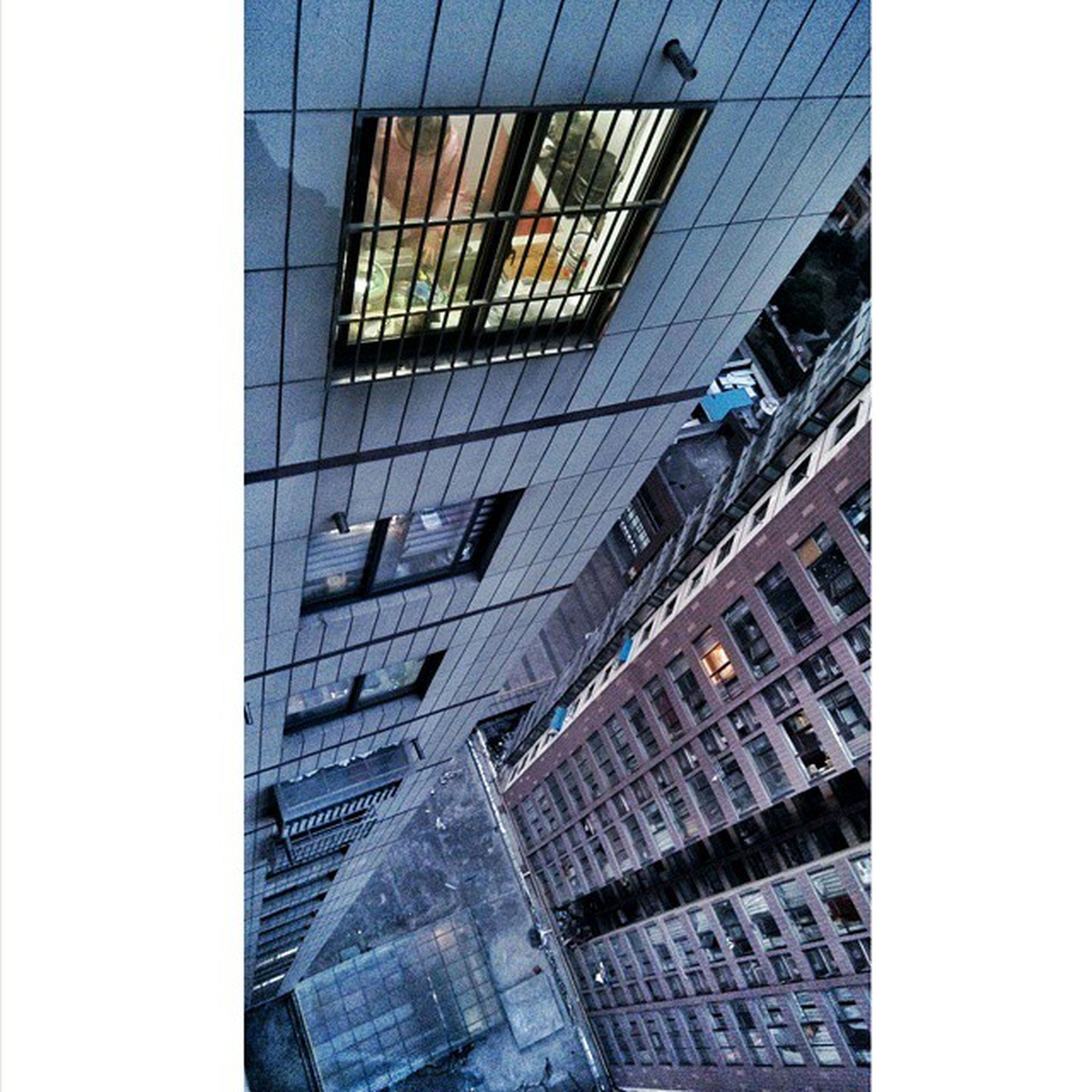 architecture, built structure, building exterior, low angle view, modern, city, building, office building, window, glass - material, reflection, transfer print, clear sky, auto post production filter, skyscraper, city life, tall - high, tower, residential building, day