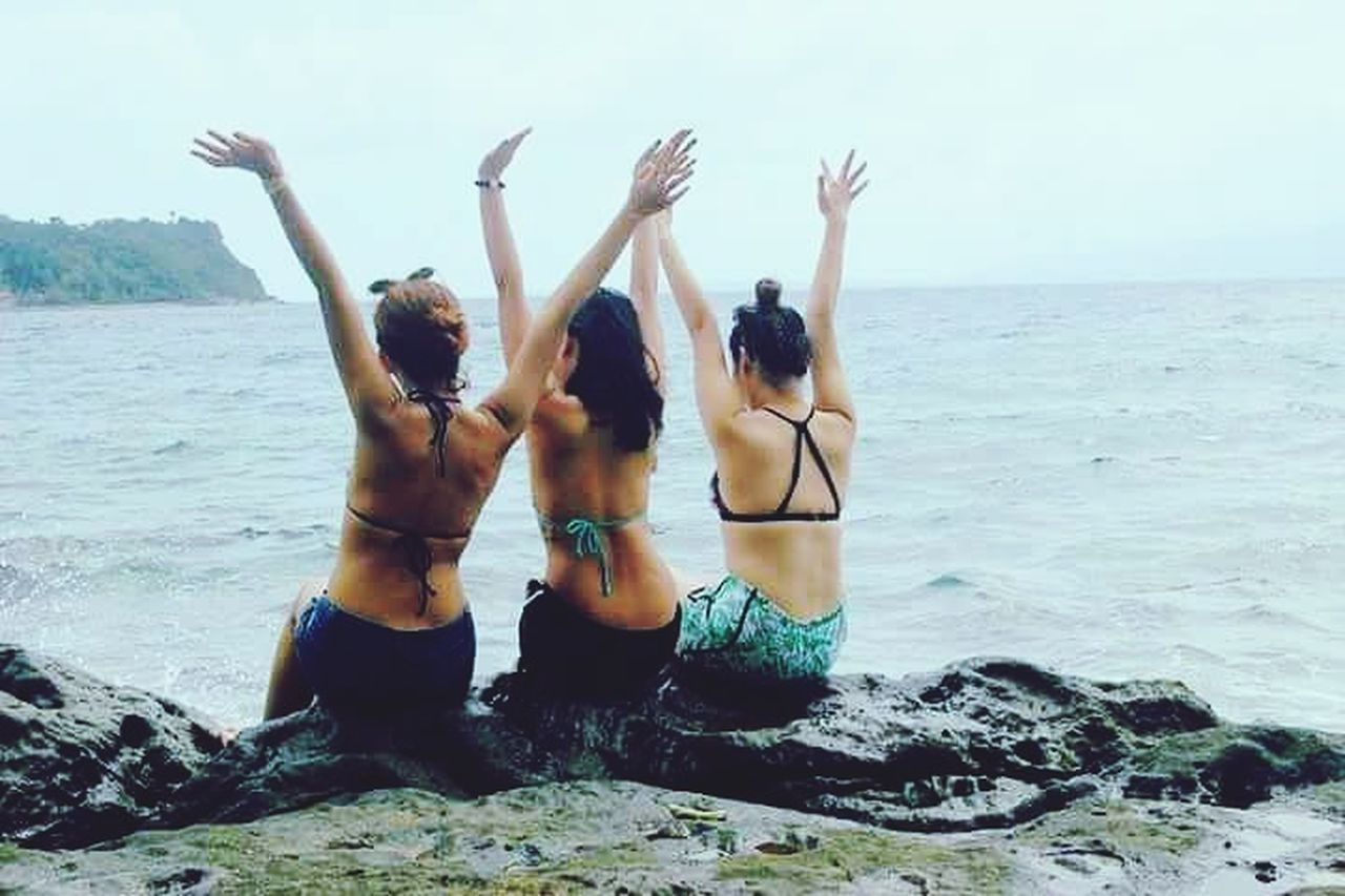 EyeEmNewHere Togetherness Friendship Young Women Bonding Beach Hand Raised Women Sea Vacations EyEmNewHere Beauty In Nature Travel Beach Life Travel Destinations Beach Photography Nature Photography Goals 💪 Goals Backpacker Happiness ♡ Girlpower GirlsJustWannaHaveFun Women Around The World