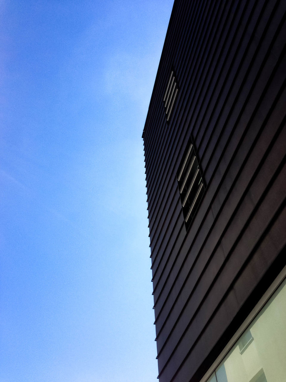 low angle view, architecture, built structure, building exterior, copy space, day, blue, no people, outdoors, clear sky, modern, sky, city, close-up