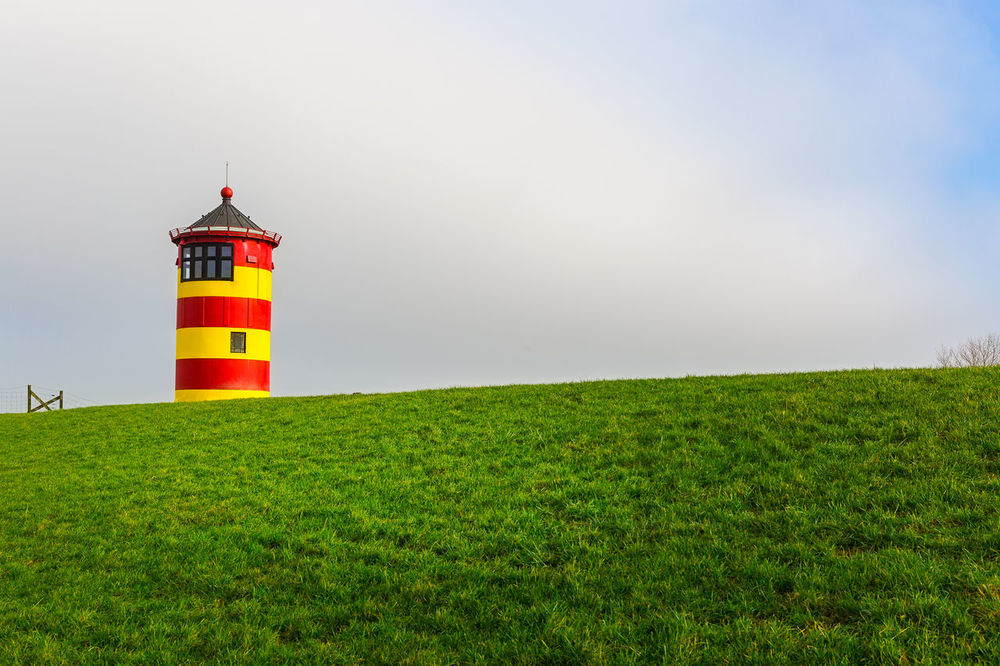 The Lighthouse of Pilsum in Eastfrisia, Germany Cloud Clouds And Sky Colors Easfrisia Frisia Germany Grass Leuchtfeuer Lighthouse Northern Germany Pilsum First Eyeem Photo