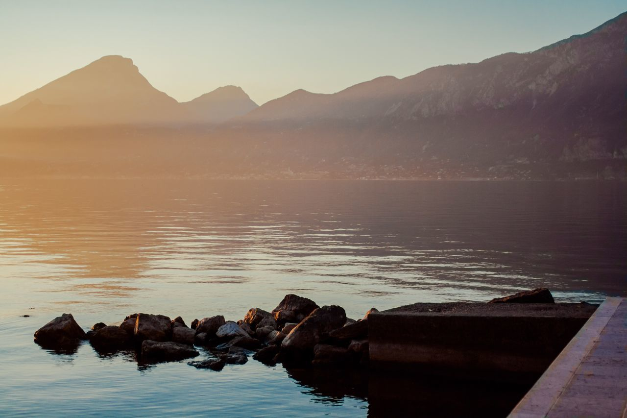 Water Nature Beauty In Nature Mountain No People Sky Outdoors Landscape Day Reflection Clear Sky Tranquility Horizon Over Water Photo Of The Day Sunlight Italy Italy Holidays Italy Photos Gardasee Garda Sunshine Beauty In Nature Nature Sun Tranquil Scene