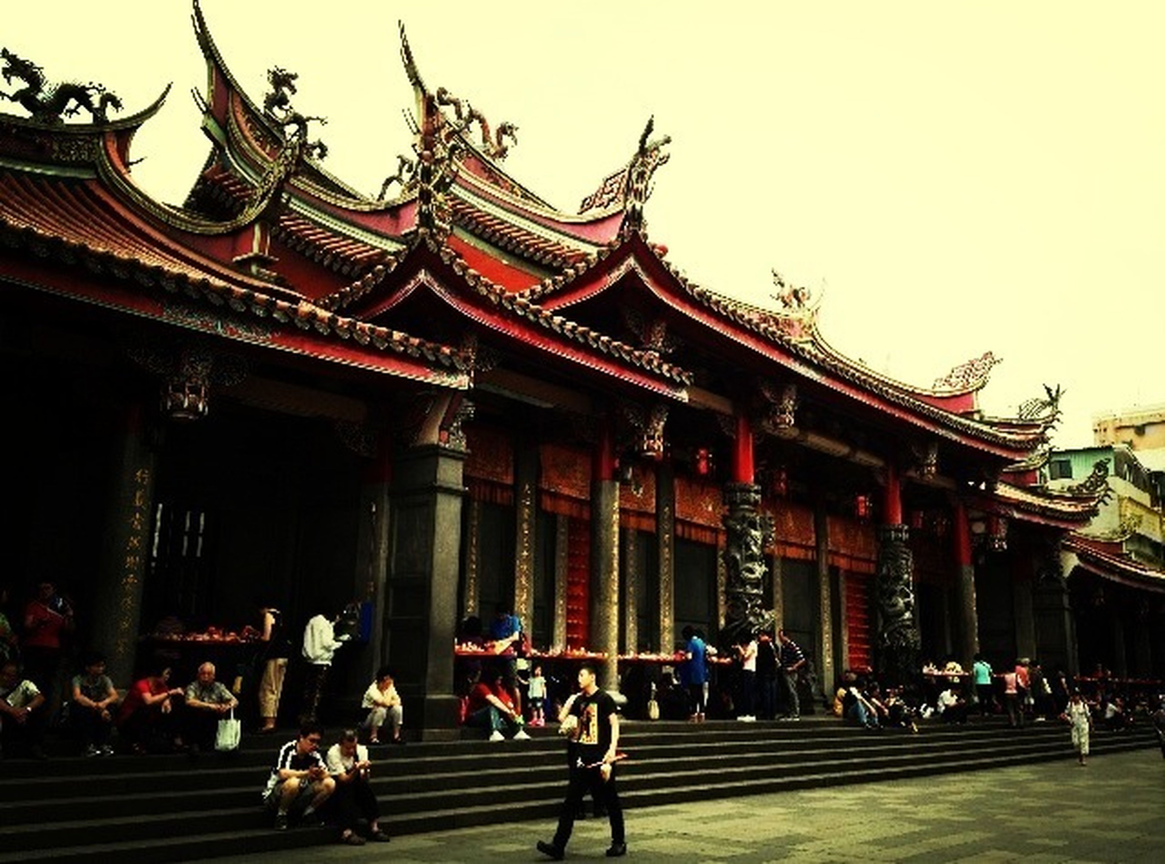 architecture, built structure, building exterior, large group of people, person, facade, temple - building, place of worship, religion, travel destinations, men, spirituality, famous place, clear sky, tradition, lifestyles, tourism, cultures, low angle view