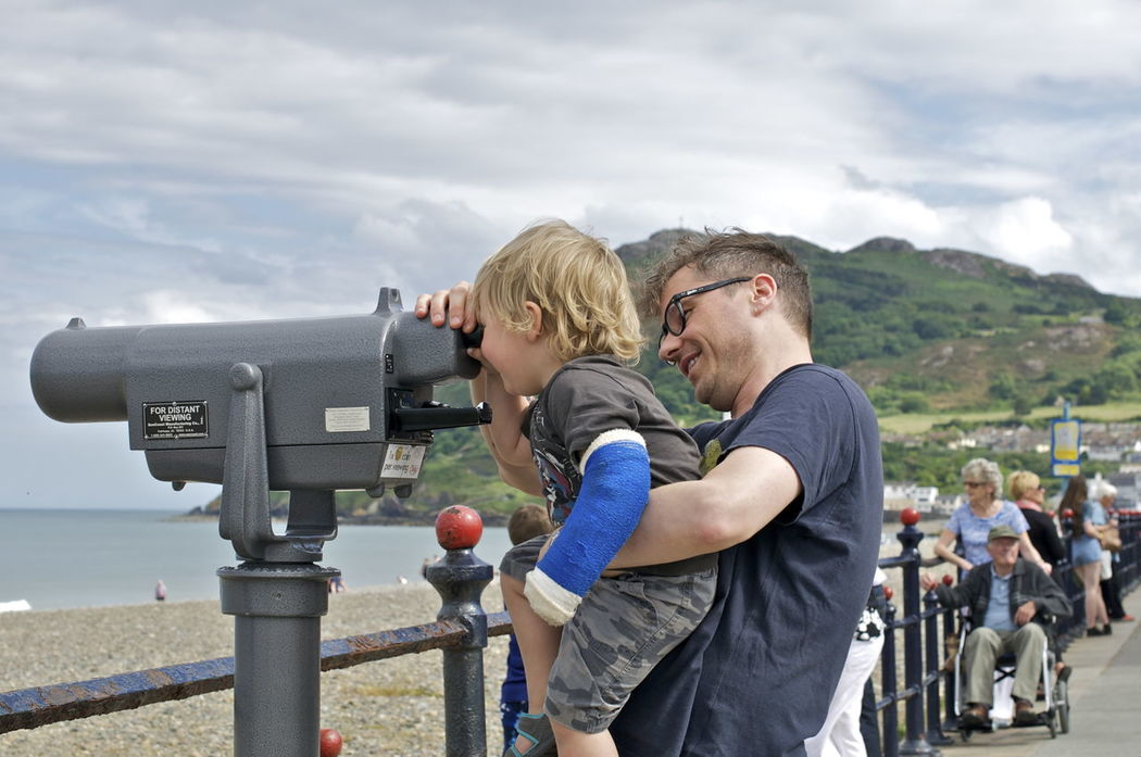 Arm Beach Binoculars Boy Clouds Daddy EyeEmFiveSenses Father & Son Holding No Edit/no Filter Promenade Seaside Sight Streetphotography Uplifting View Seeing The Sights Capture The Moment Once In A Lifetime