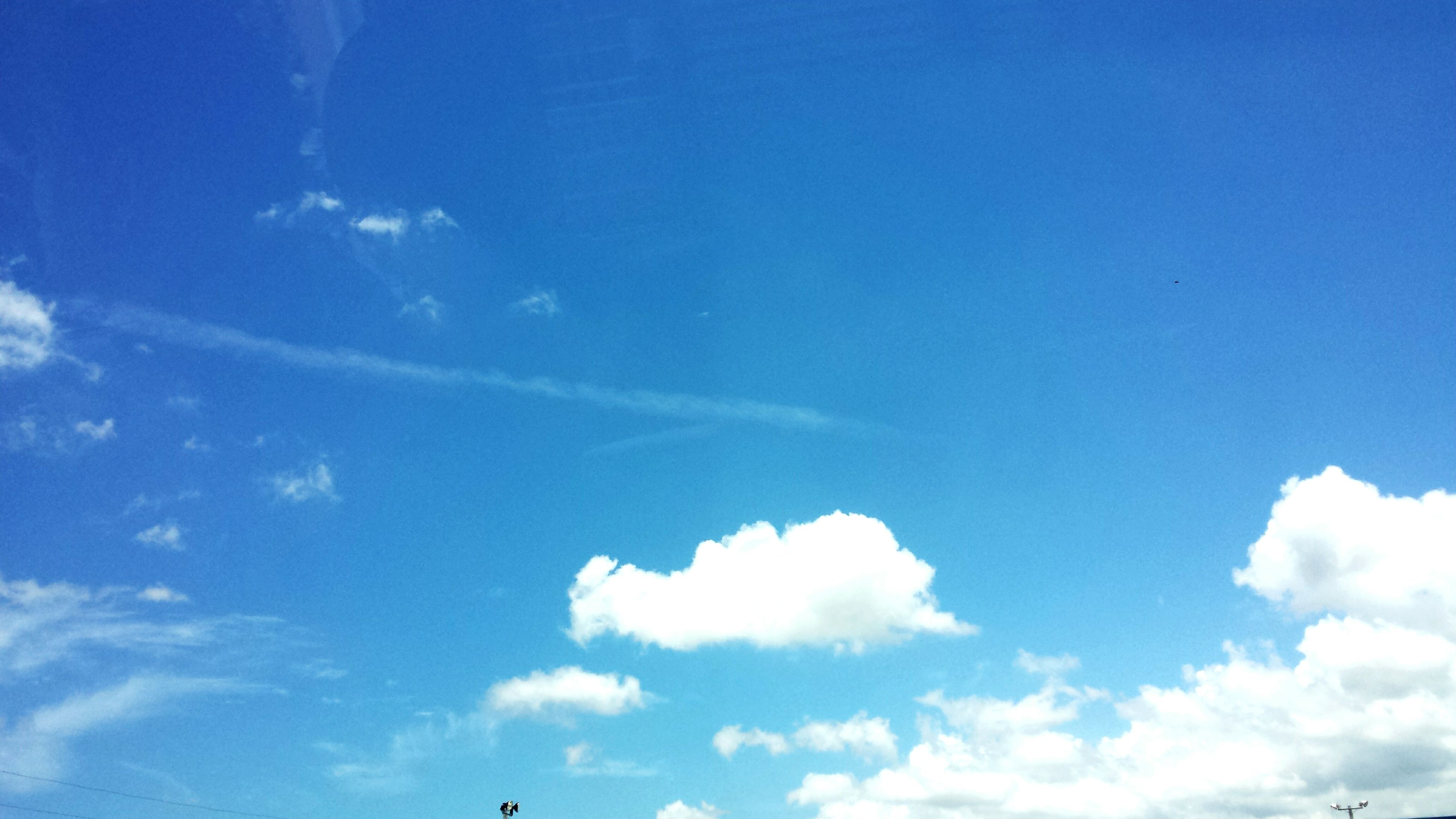 blue, low angle view, sky, beauty in nature, tranquility, nature, cloud - sky, sky only, scenics, tranquil scene, cloud, day, outdoors, copy space, white color, no people, idyllic, sunlight, backgrounds, cloudscape