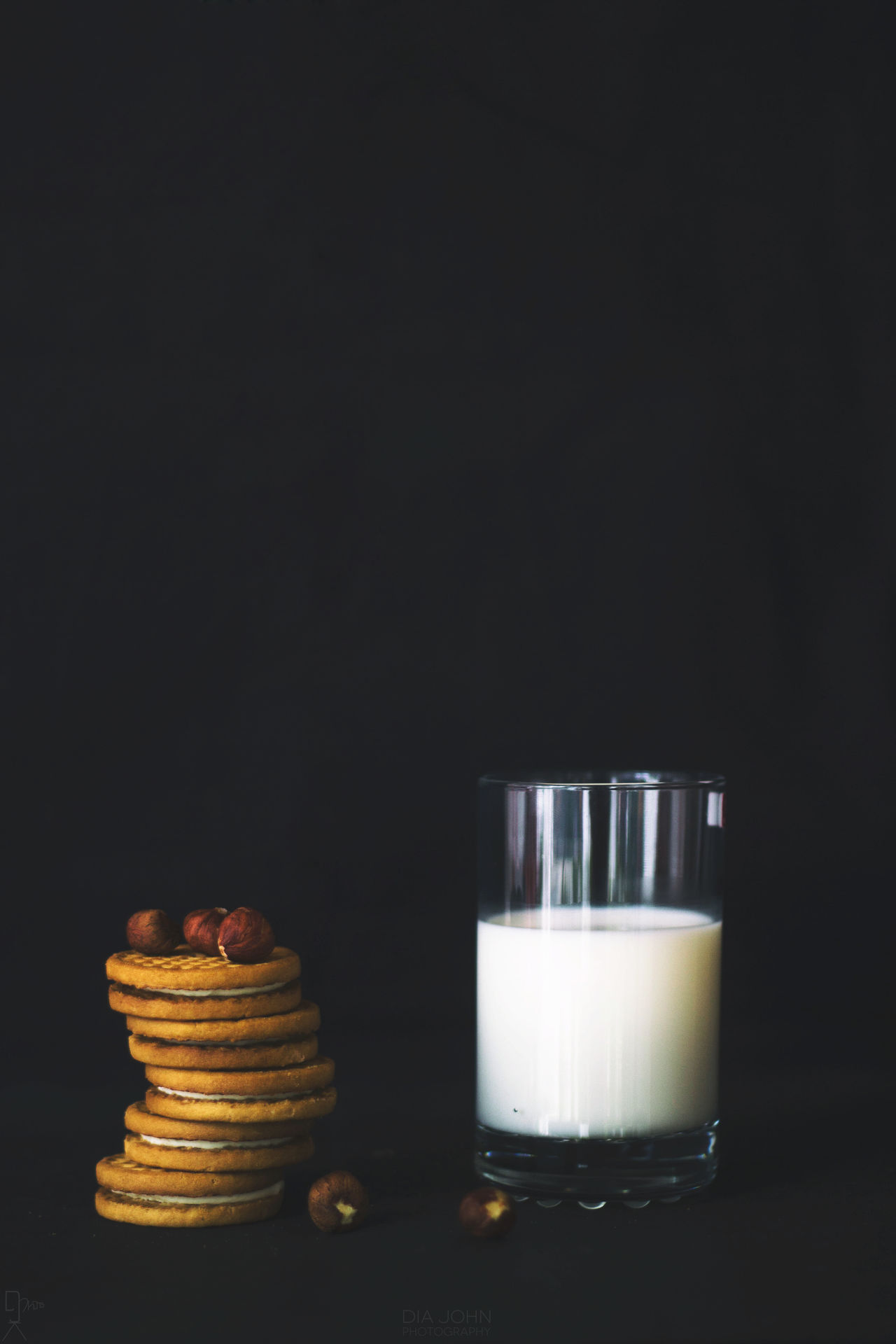 Hazelnuts,Biscuits and Glass of Milk Arrangement Biscuits Black Background Breakfast Creambiscuits Dark Glass Glassofmilk Hazelnuts Milk Milkandbiscuits No People Side By Side Still Life First Eyeem Photo
